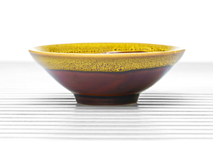 Maroon Glazed Conical Tea Bowl With Yellow And Brown Speckled Rim